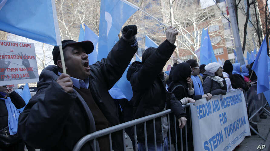 Uighurs and their supporters protest in front of the Permanent Mission of China to the United Nations in New York, March 15, 2018. Members of the Uighur Muslim ethnic group held demonstrations in cities around the world on that day to protest a sweep