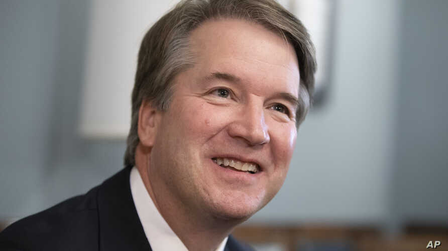 FILE - Supreme Court nominee Judge Brett Kavanaugh smiles during a meeting with Sen. Mike Lee, R-Utah, on Capitol Hill in Washington, July 18, 2018.