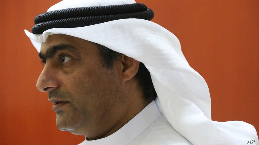 FILE - Human rights activist Ahmed Mansoor speaks to Associated Press journalists in Ajman, United Arab Emirates, Aug. 25, 2016.