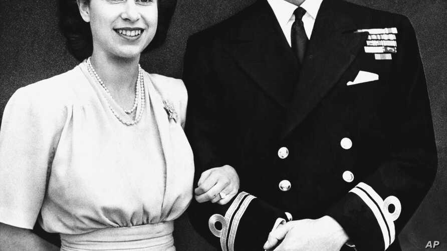 FILE - Britain's Princess Elizabeth heir to the British throne, and her fiance, Lieutenant Philip Mountbatten, July 10, 1947, announce their engagement in London.