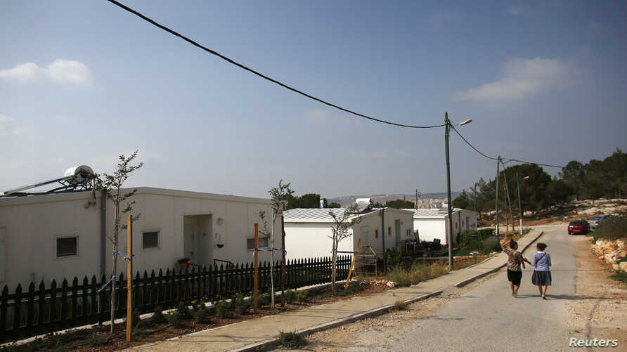"Israeli women walk in a Jewish settlement known as ""Gevaot"" - in the Etzion settlement bloc - near Bethlehem, Aug. 31, 2014."