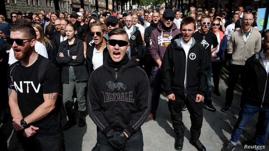 Supporters of the neo-Nazi Nordic Resistance Movement chant slogans during a demonstration at Kungsholmstorg square in Stockholm, Sweden Aug. 25, 2018. (TT News Agency/Fredrik Persson via Reuters)