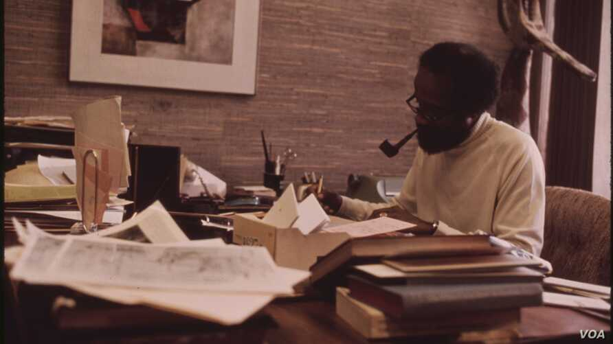 FILE - Lerone Bennett working in his office at the Johnson Publishing Company in Chicago in October 1973.