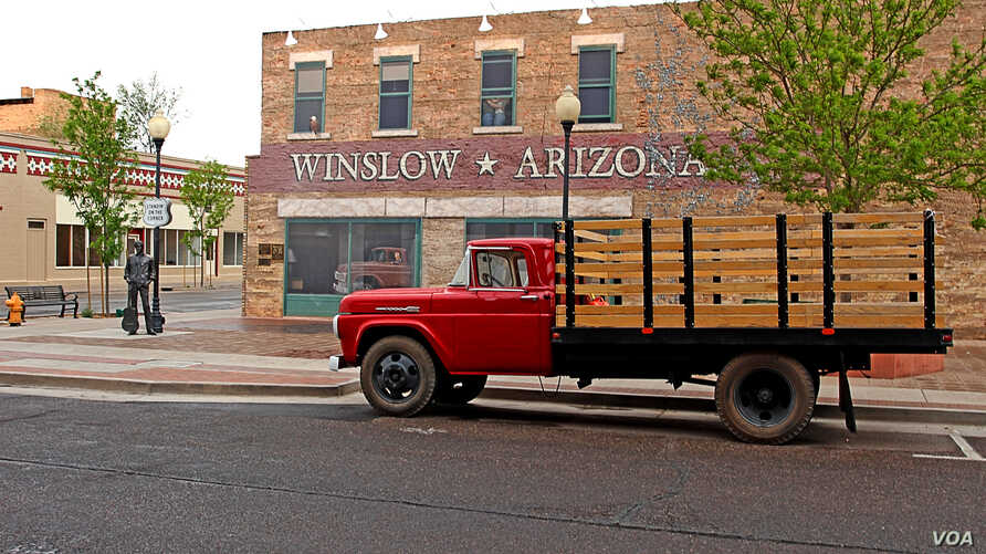 A flatbed Ford truck permently parked at a corner in Winslow, Ariz., as a tribute to the Eagles song 'Take it Easy,' written by Jackson Browne & Glenn Frey.
