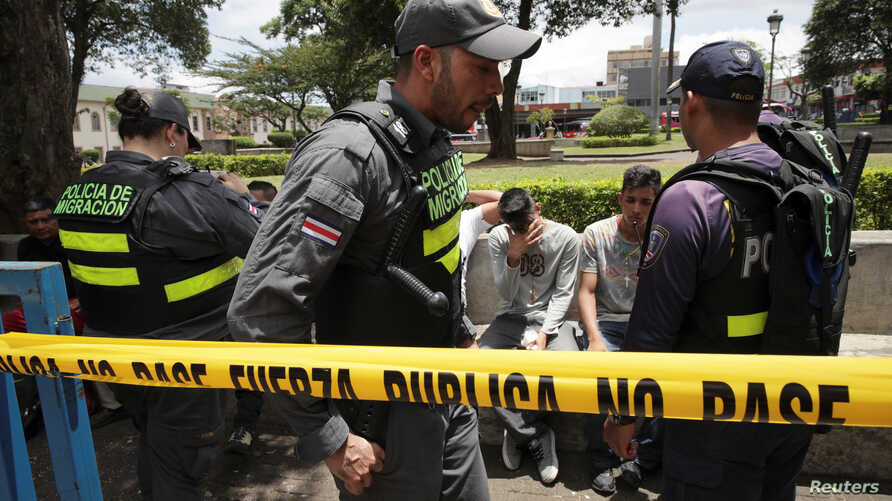 Nicaraguans are detained by immigration police officers in San Jose, Costa Rica, Aug. 19, 2018.