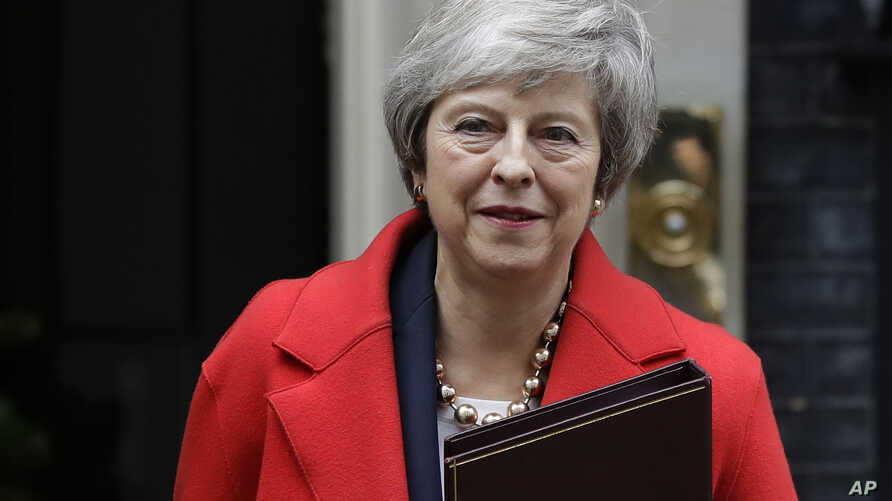 Britain's Prime Minister Theresa May leaves Downing Street in London, Dec. 4, 2018.