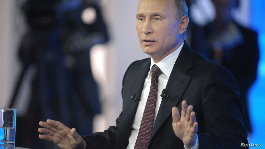 Russian President Vladimir Putin hosts a live televised call-in show, in Moscow, April 17, 2014.