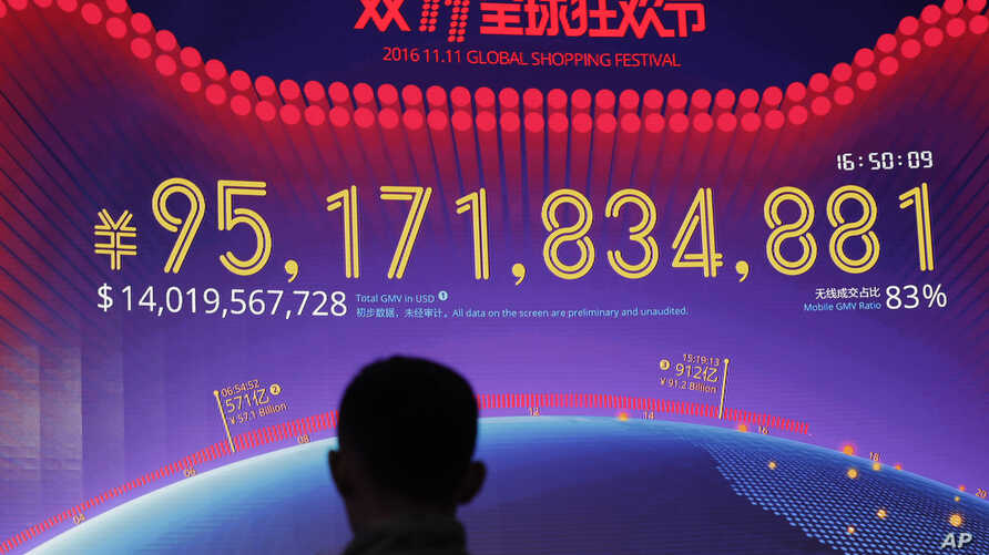 """A giant screen showing a total sales transacted of e-commerce giant Alibaba, on the """"Singles' Day"""" global online shopping festival in Shenzhen, southern China's Guangdong province, Nov. 11, 2016."""