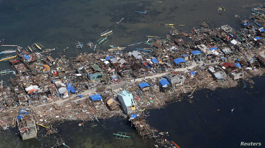 An aerial view of a fishing village in Guiwan town, devastated by super Typhoon Haiyan, in Samar province in central Philippines Nov. 11, 2013.
