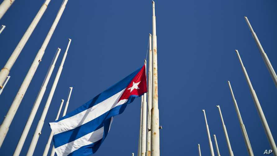 A Cuban flag flies at half-mast after the death of Fidel Castro, at the anti-imperialist tribune in Havana, Cuba, Nov. 26, 2016. Castro, who led a rebel army to improbable victory in Cuba, embraced Soviet-style communism and defied the power of U.S.