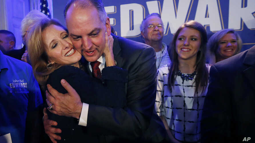 Louisiana Gov.-elect John Bel Edwards hugs his wife Donna Edwards as he arrives to greet supporters at his election night watch party in New Orleans, Nov. 21, 2015.