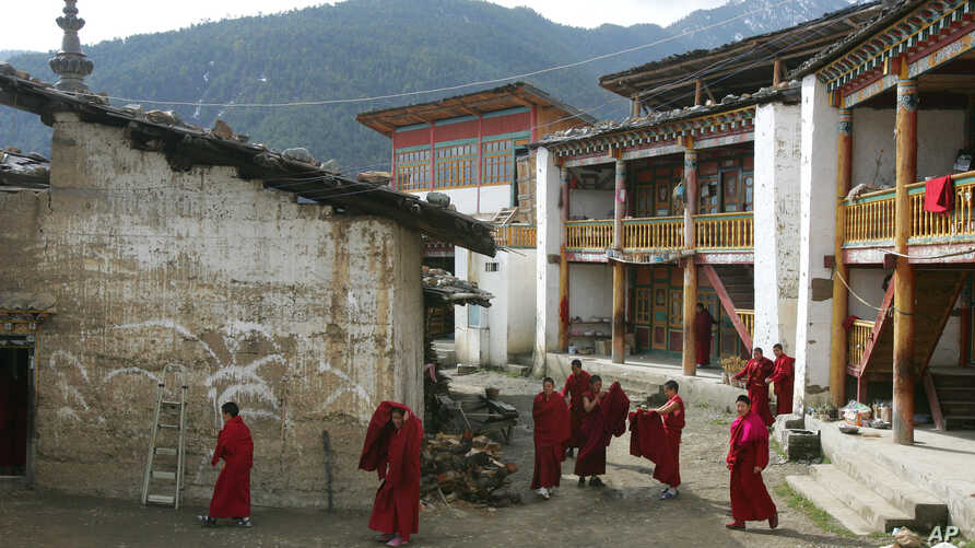 FILE - Tibetan nuns walk through the grounds of the Taibaling Nunnery at Shusong Village, in the mountains about 50 kilometers (31 miles) from the border with Tibet, in China's southwest Yunnan province on March 25, 2008. The nunnery was rebuilt on t