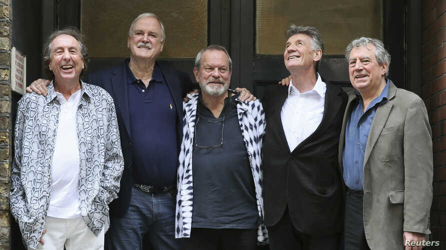 Members of British comedy troupe Monty Python, from left, Eric Idle, John Cleese, Terry Gilliam, Michael Palin and Terry Jones pose for a photograph during a media event in central London, June 30, 2014.