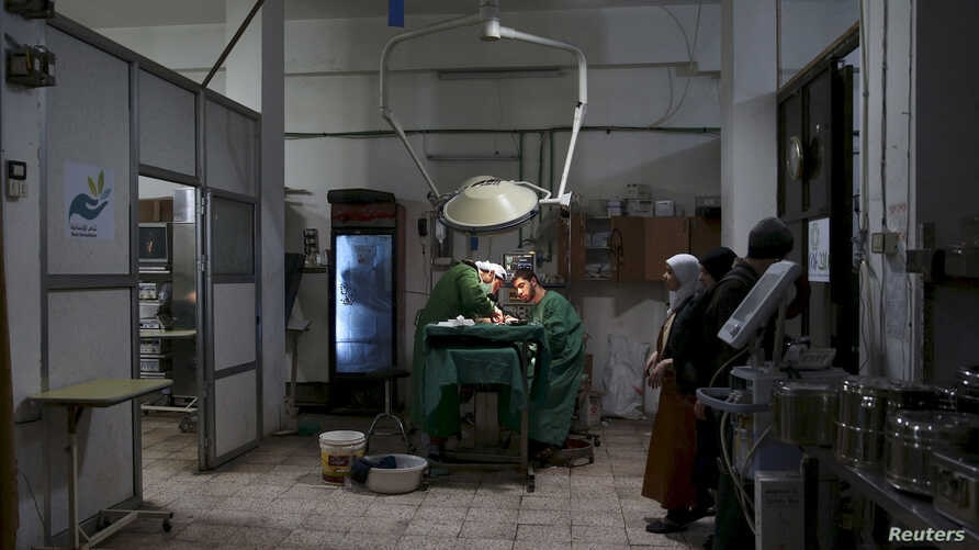 Doctors treat an injured civilian in a field hospital after what activists said was shelling by forces of Syria's President Bashar al-Assad in the Douma neighbourhood of Damascus, Eastern Ghouta, Syria November 19, 2015.