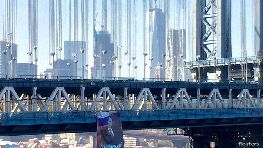 A banner with an image of Russian President Vladimir Putin hangs from the Manhattan Bridge in New York City, on October 6, 2016.