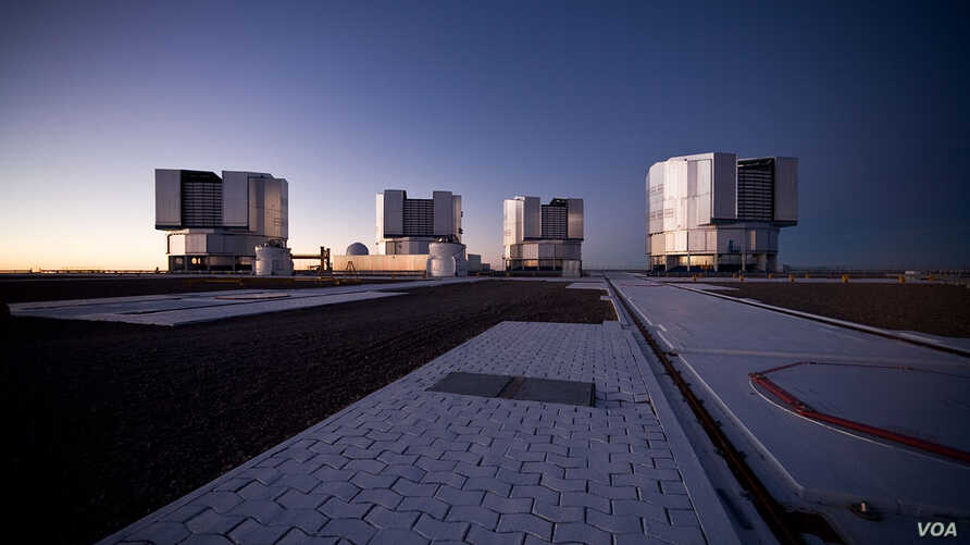 This image of the Paranal platform of the Four Unit Telescopes of the Very Large Telescope was taken right after sunset. (Credit: ESO/H.H.Heyer)
