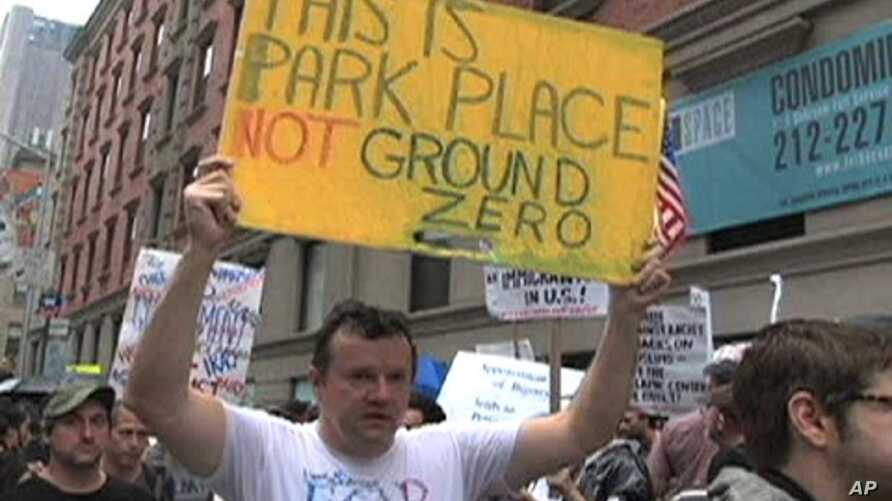 Protesters in New York City hold posters to express their opinions about the proposed Islamic Center to be built near the site of the September 11, 2001 terror attacks, 22 Aug 2010