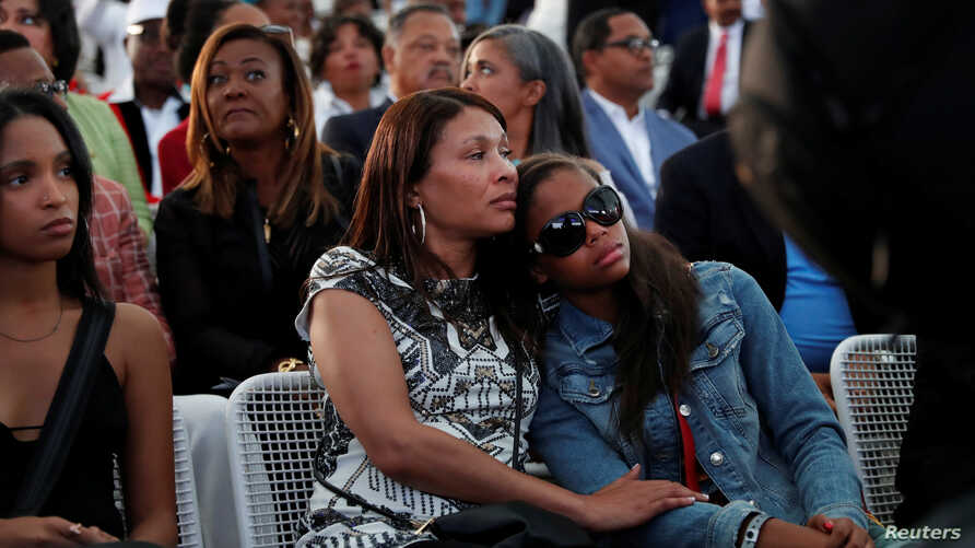 One of Aretha Franklin's granddaughters (R) is comforted as she sheds tears during a live rendition of Amazing Grace at a free tribute concert to the late Aretha Franklin at Chene Park in Detroit, Michigan, U.S. August 30, 2018.