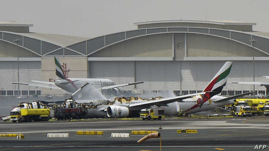 A picture shows a Boing 777 of the UAE airliner Emirates after it caught fire following a crash-landing at Dubai airport on August 3, 2016.