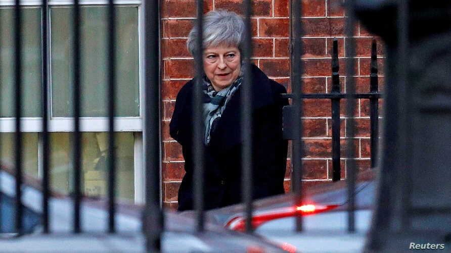 Britain's Prime Minister Theresa May leaves 10 Downing Street in Westminster London, Dec. 13, 2018.
