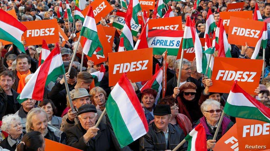 Supporters of Hungarian Prime Minister Viktor Orban are seen before his campaign closing rally in Szekesfehervar, Hungary, April 6, 2018.