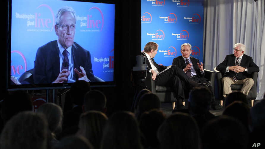 Former Washington Post reporter Bob Woodward, is seen on the monitor as moderator Charlie Rose, left, former WP reporters Bob Woodward, and Carl Bernstein, speak during an event sponsored by WP to commemorate the 40th anniversary of Watergate, Washin
