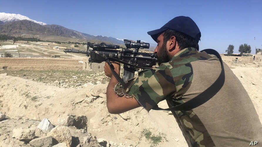 An Afghan commando stands guard at Pandola village, near the site of the U.S. forces' bombing in Achin district of Jalalabad, east of Kabul, Afghanistan, April 14, 2017.