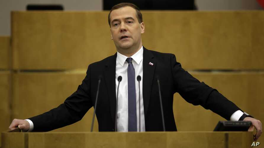 FILE - Russian Prime Minister Dmitry Medvedev says Russia contests sanctions it faces over the crisis in Ukraine.
