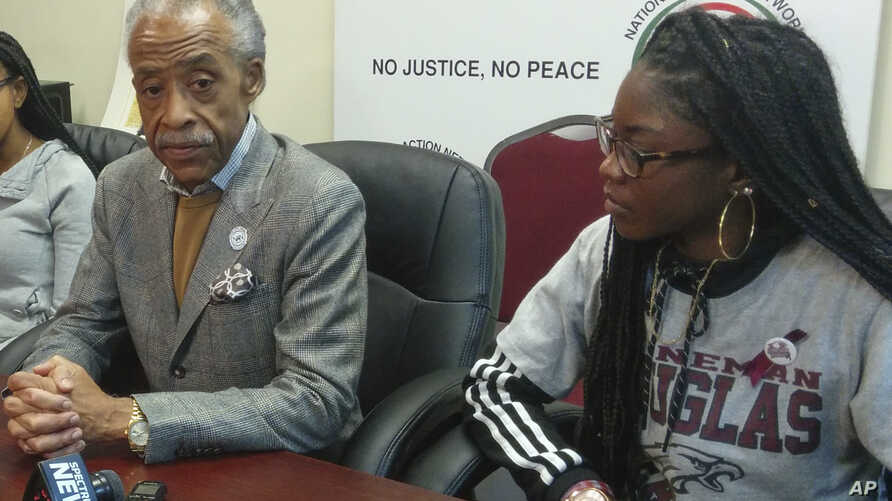 The Rev. Al Sharpton is joined by Aalayah Eastmond, a junior at Marjory Stoneman Douglas High School in Parkland, Fla., during the National Action Network weekly meeting, April 7, 2018, in the Harlem neighborhood of New York. Eastmond and Sharpton an