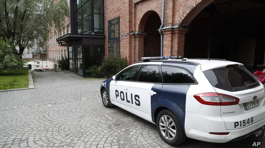 FILE - A police car parks outside Pirkanmaa district court in Tampere, Finland, where five members of Cuba's national volleyball team were convicted Tuesday of aggravated rape.