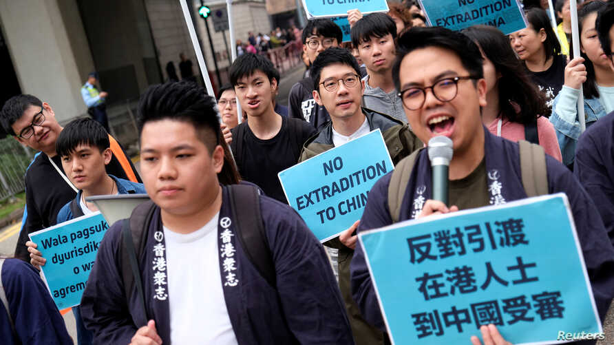 Demonstrators march during a protest to demand authorities scrap a proposed extradition bill with China, in Hong Kong, China, March 31, 2019.