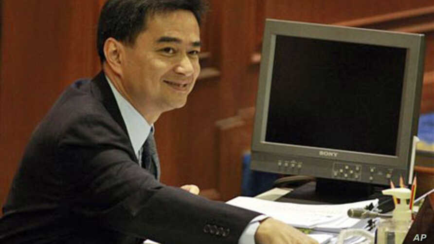 Thai Prime Minister Abhisit Vejjajiva takes his seat at parliament for a no-confidence debate, March 15, 2011 in Bangkok, Thailand