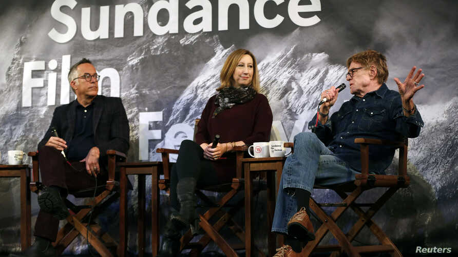 Sundance Film Festival director John Cooper (L-R), executive director Keri Putnam and founder Robert Redford address the media at an opening day news conference for the festival at the Egyptian Theatre in Park City, Utah, Jan. 22, 2015.