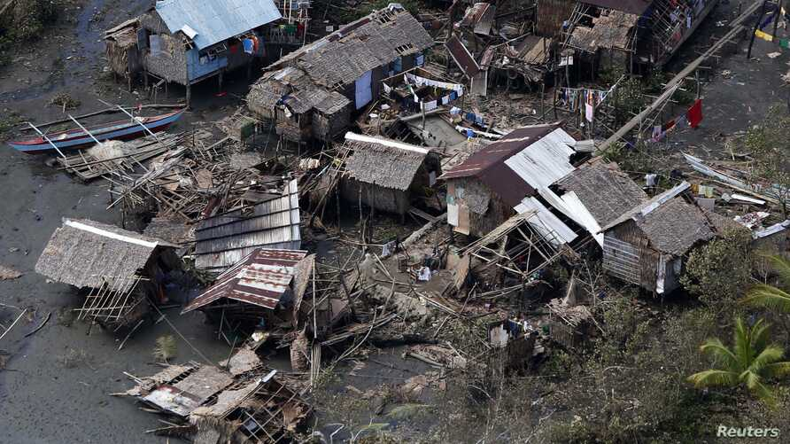 An aerial view of houses destroyed by typhoon Hagupit at a village in Dolores, Eastern Samar, central Philippines, December 9, 2014.
