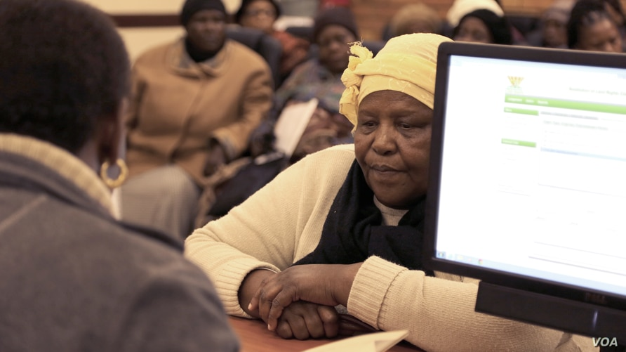 Emilia Khoza, evicted from her house when she was eight years old, at the Pretoria Land Claims office, Pretoria, South Africa. (Gillian Parker/VOA