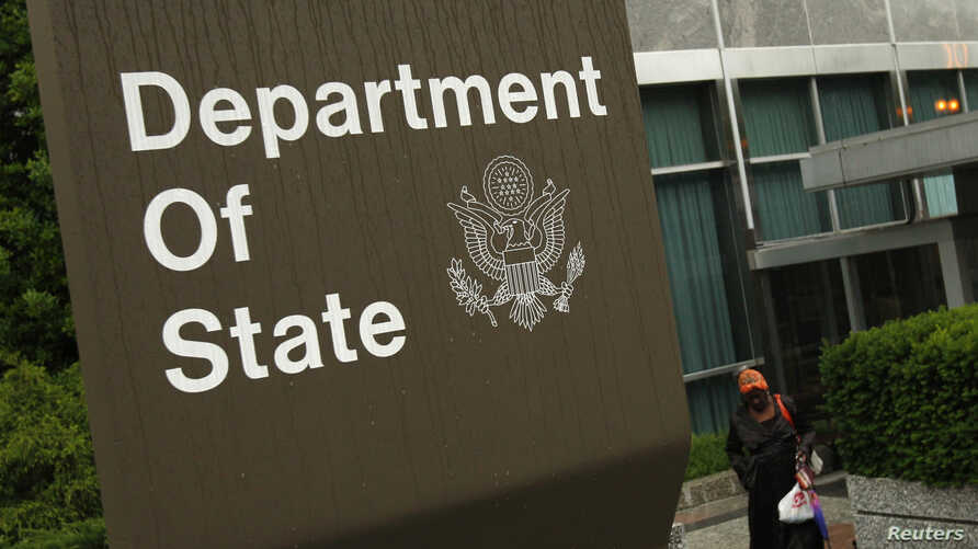 A woman leaves the U.S. State Department building in Washington June 5, 2009