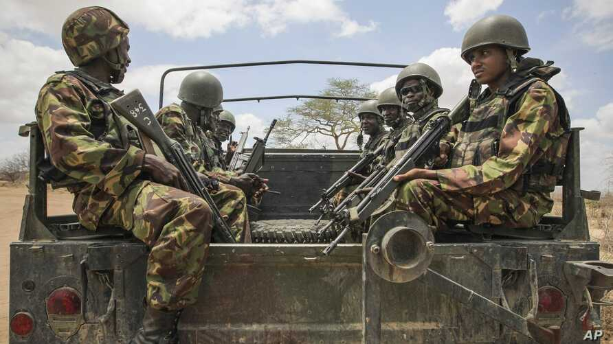 In this photo released by the African Union-UN Information Support Team, Kenyan soldiers serving with the African Union Mission in Somalia at their sector headquarters in the town of Dhobley, Somalia, September 30, 2012.