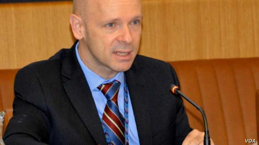 FILE - Thomas Hushek delivers remarks at a briefing in Vienna, Austria, Sept. 15, 2014. (Twitter - @usunvie)