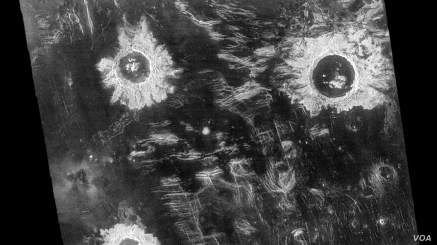 Three large meteorite impact craters are seen in this image of the Lavinia region on Venus. Situated in a region of fractured plains, the craters show many features typical of meteorite impact craters, including rough (bright) material around the rim
