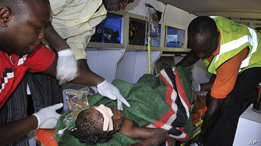 A victim is tended to by medics in an ambulance following a blast at a Catholic church near Nigeria's capital Abuja, December 25, 2011.