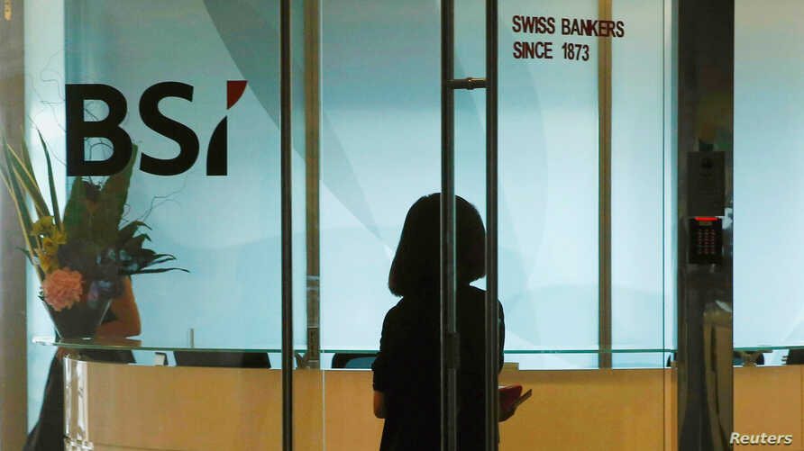 An employee enters the reception area of Swiss bank BSI's office in Singapore, May 24, 2016.