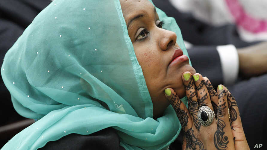 Deeqo Jibril, of Boston and founder of the Somali Community and Cultural Association, listens as President Barack Obama speaks at the White House Summit on Countering Violent Extremism, Feb. 18, 2015.