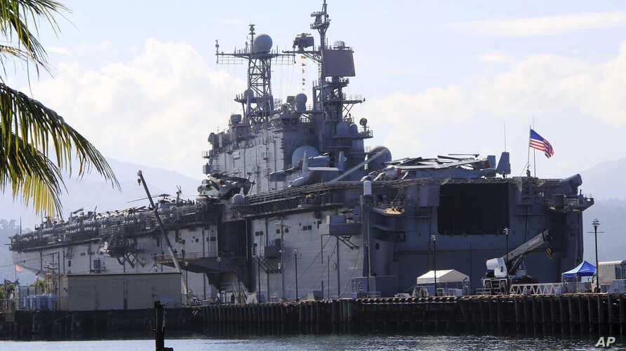 The amphibious assault ship USS Peleliu, which took part in the joint military exercise with their Philippine counterpart, is docked at the Alava pier, off Subic Bay Freeport zone in Zambales province, northwestern Philippines, Oct. 13, 2014.