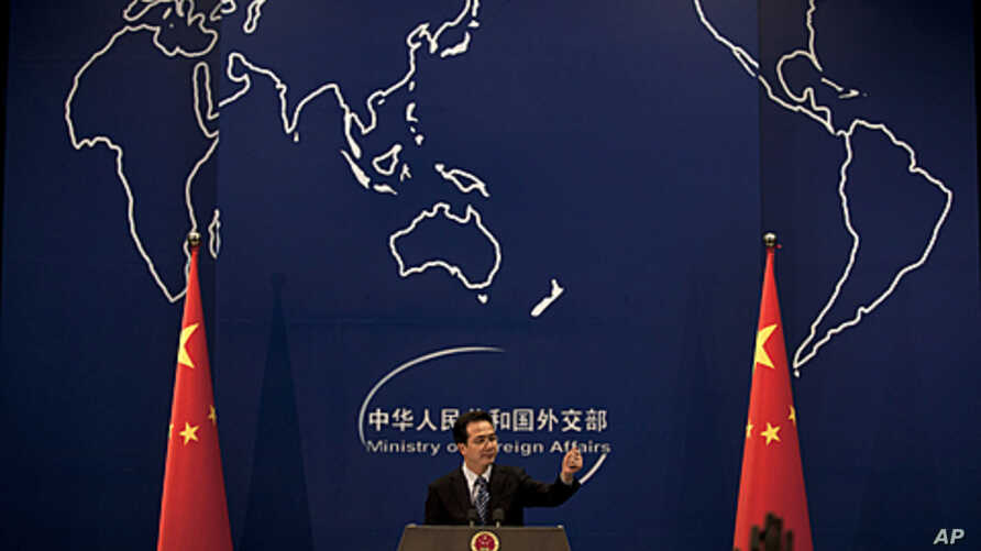 Chinese Foreign Ministry spokesman Hong Lei gestures during a news briefing at the Ministry of Foreign Affairs in Beijing, China. China, the world's most prolific executioner, put a Filipino man convicted of drug trafficking to death despite a clemen