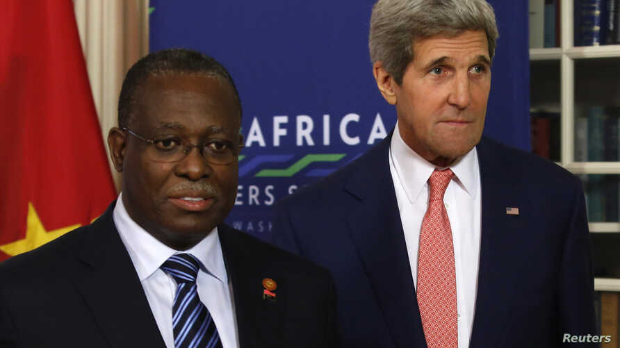 U.S. Secretary of State John Kerry (R) meets with Vice President of Angola Manuel Vicente at the State Department in Washington, Aug. 4, 2014.