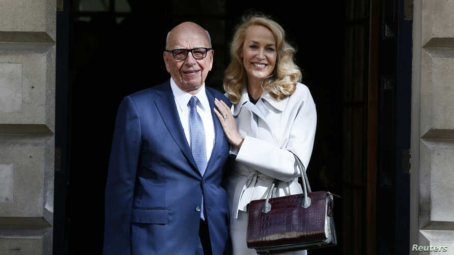 Media mogul Rupert Murdoch and Jerry Hall pose for a photograph in London, Britain March 4, 2016.