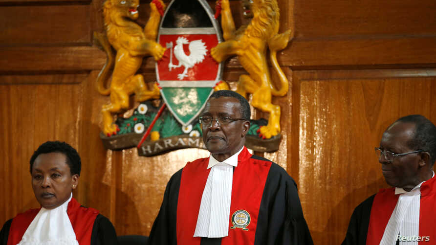 Kenya's Supreme Court judge chief justice David Maraga, center, presides before delivering the ruling making last month's presidential election declared invalid, Sept. 1, 2017.