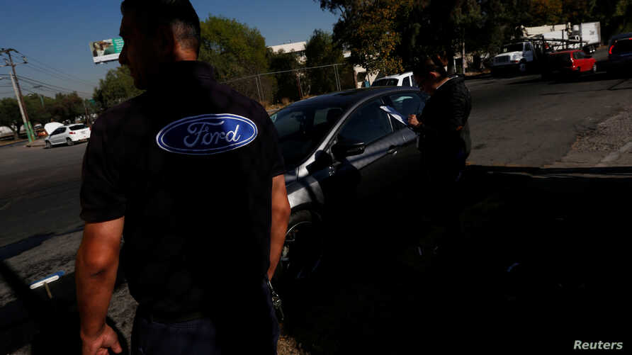 The Ford logo is seen on a t-shirt of an employee in Cuautitlan Izcalli, Mexico, Jan. 4, 2017.