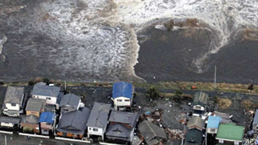 Houses are damaged by water following a tsunami and earthquake in Ibaraki city, Ibaraki Prefecture, Mar 11 2011