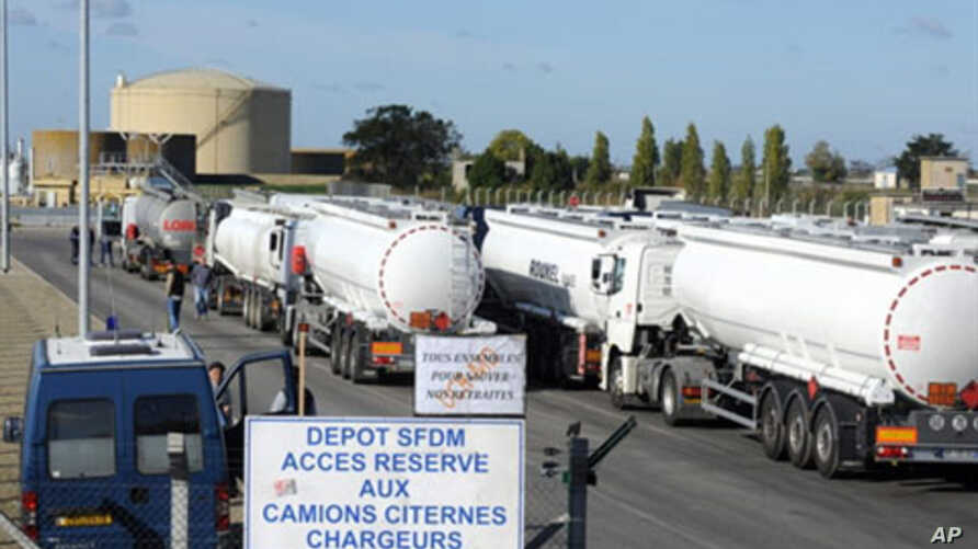 Tanker trucks load fuel at the refinery of French oil giant Total in Donges, 25 October 2010